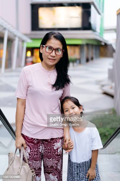 Portrait Of Smiling Mature Woman With Daughter