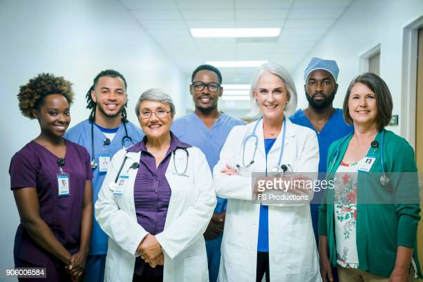 portrait of smiling medical team - group of doctors stock pictures, royalty-free photos & images
