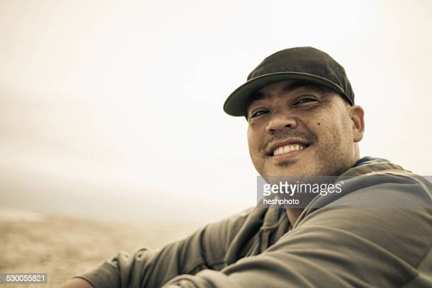 portrait of smiling mid adult man on beach, truro, massachusetts, cape cod, usa - heshphoto stock pictures, royalty-free photos & images