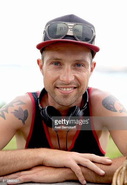 Portrait of smiling mid adult man wearing baseball cap at coast