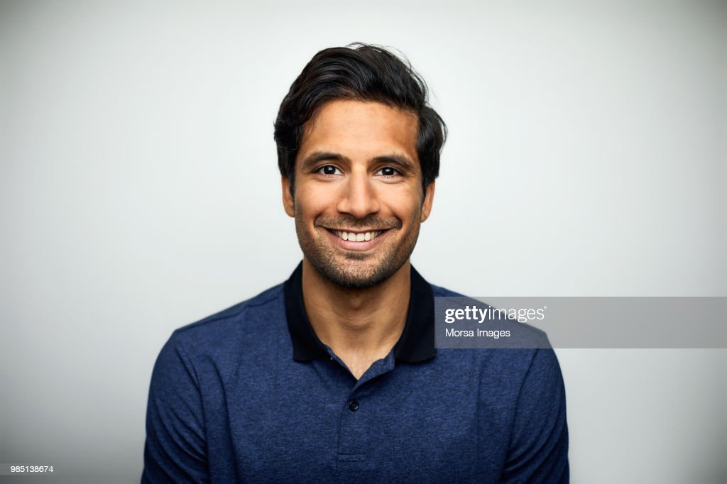 Portrait of smiling mid adult man wearing t-shirt : Stock Photo