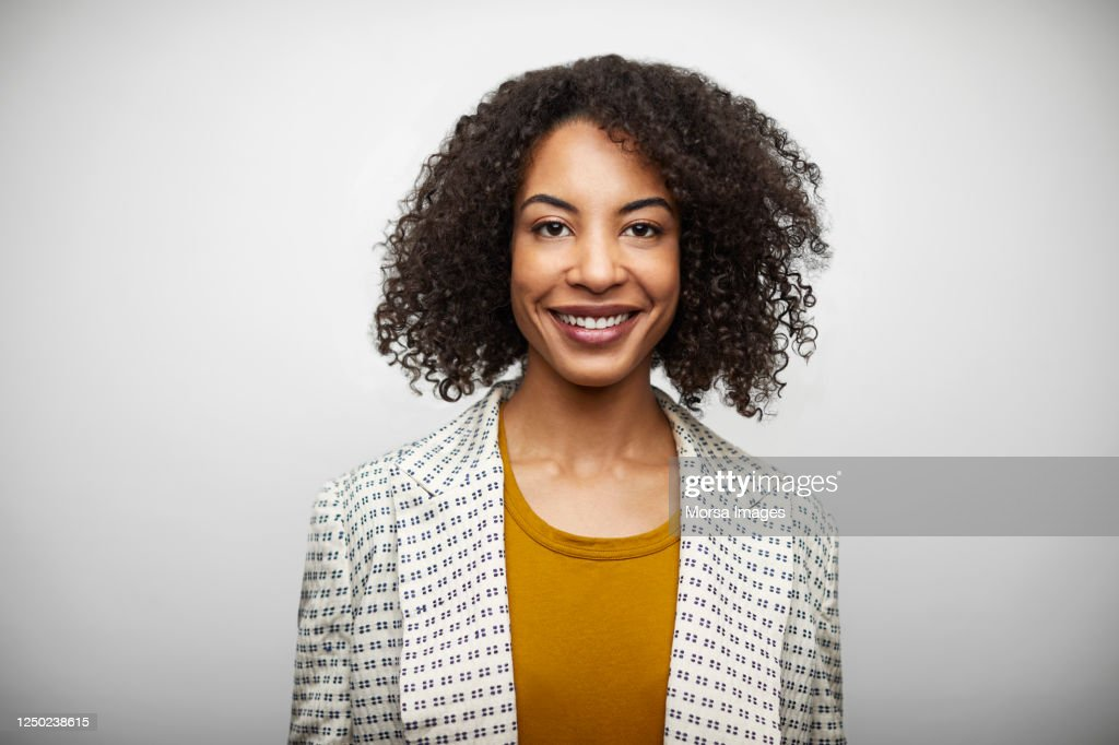 Portrait Of Smiling Mid Adult Woman In Casuals : Photo