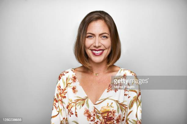 portrait of smiling mid adult woman in casuals - blouse stock pictures, royalty-free photos & images