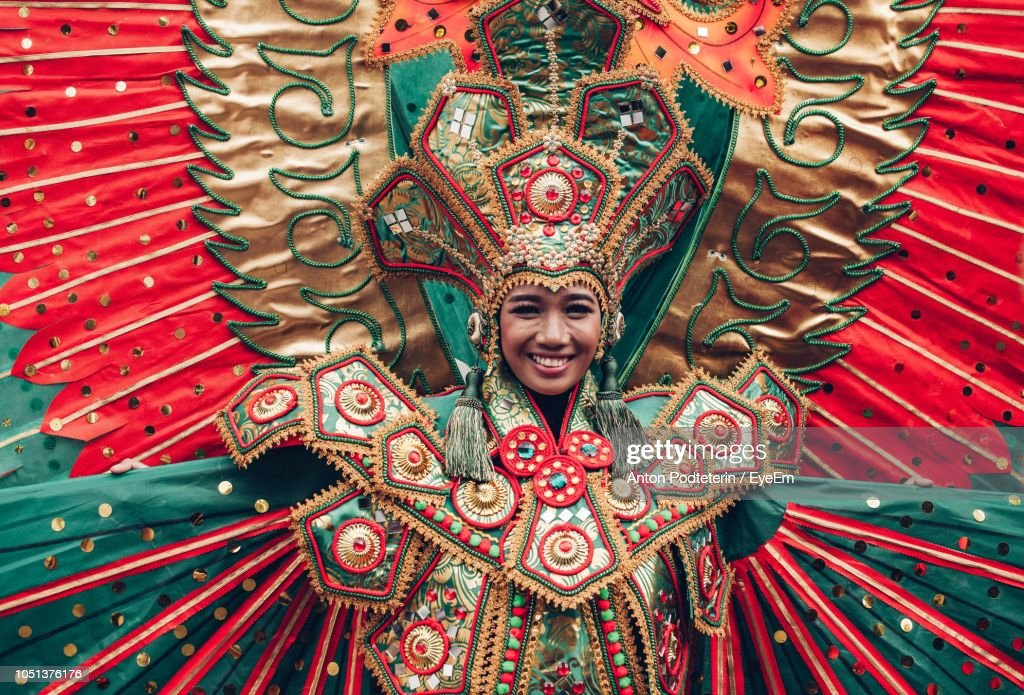 Portrait Of Smiling Mid Adult Woman Wearing Costume During Traditional Festival : Stock Photo