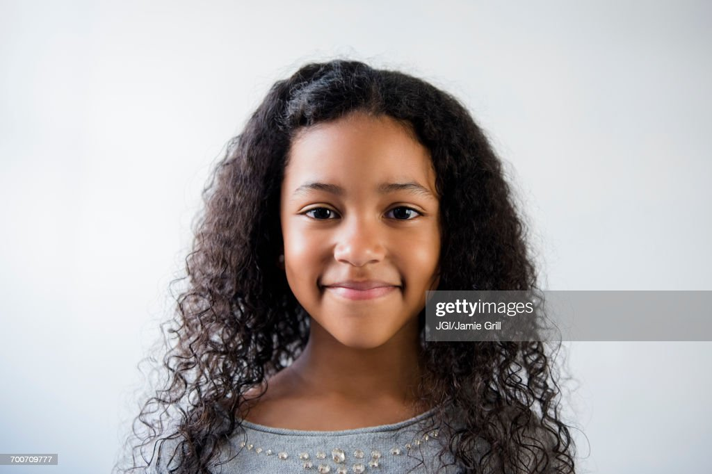 Portrait of smiling Mixed Race girl : Stock-Foto