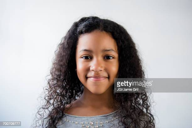portrait of smiling mixed race girl - raparigas imagens e fotografias de stock