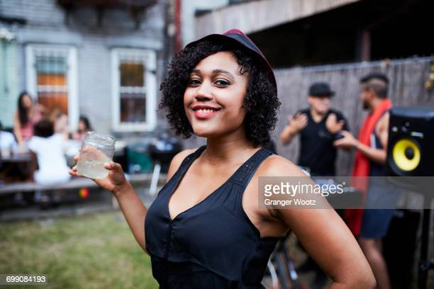 Portrait of smiling Mixed Race woman at backyard party