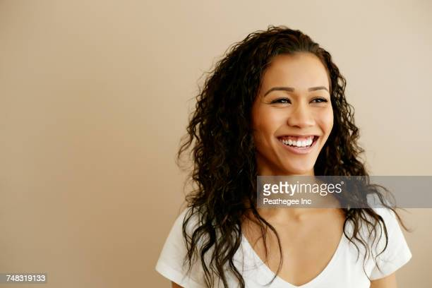 Portrait of smiling Mixed Race woman