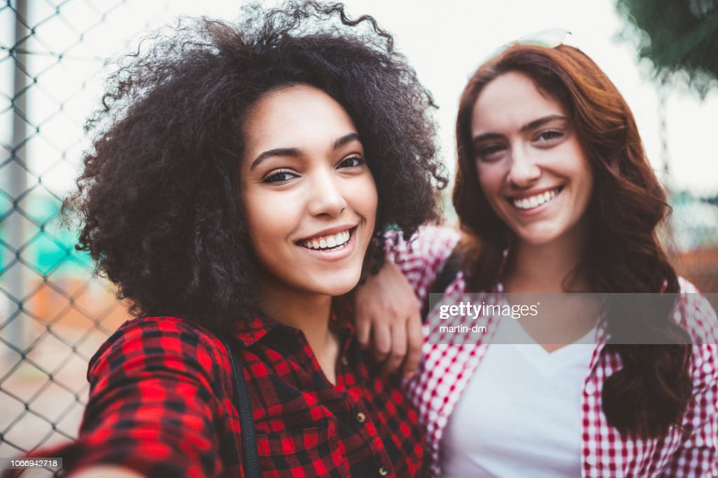 Portrait Of Smiling Mixed Race Women High Res Stock Photo Getty Images