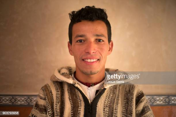 portrait of smiling moroccan - moroccan culture stock photos and pictures