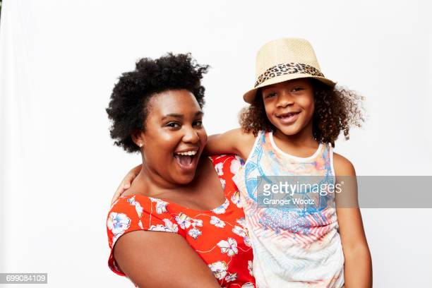 Portrait of smiling mother holding daughter