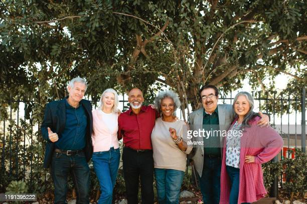 portrait of smiling multi-ethnic senior friends - 70 79 years stock pictures, royalty-free photos & images