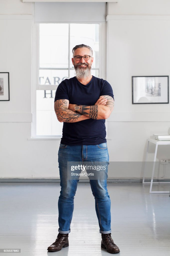 Portrait of smiling muscular Caucasian hipster man : Stock Photo