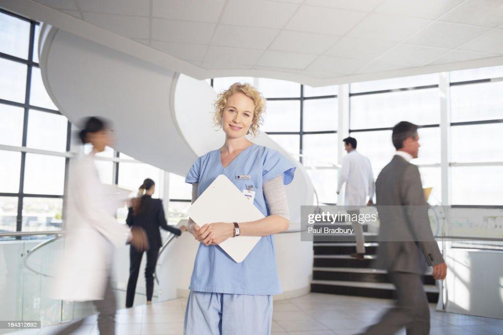 Portrait of smiling nurse in hospital : Stock Photo