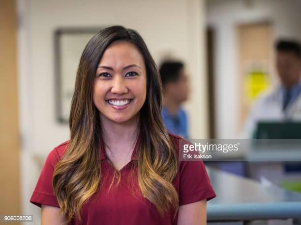 portrait of smiling nurse in hospital - filipino woman stock pictures, royalty-free photos & images