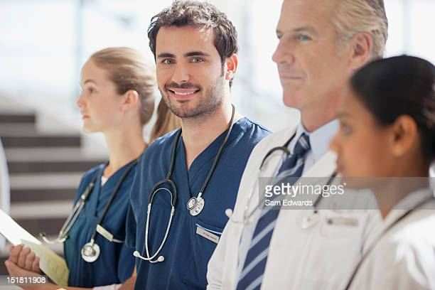 Portrait of smiling nurse with doctors