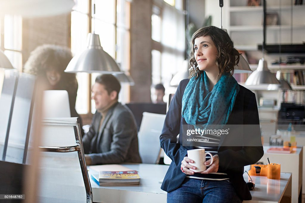 Portrait of smiling office worker relax having a coffee : Stock Photo