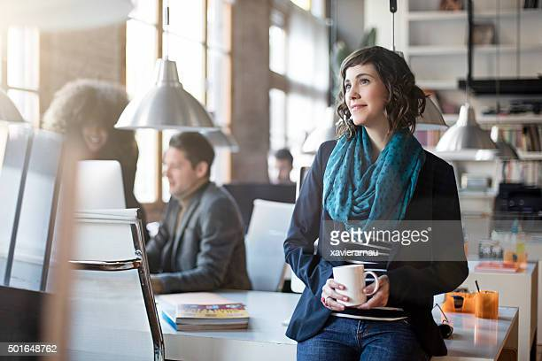 portrait of smiling office worker relax having a coffee - incidental people stock pictures, royalty-free photos & images