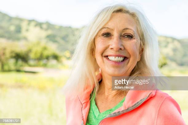 Portrait of smiling Older Caucasian woman outdoors