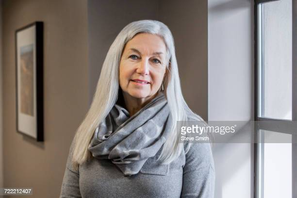 portrait of smiling older caucasian woman - long hair stock pictures, royalty-free photos & images