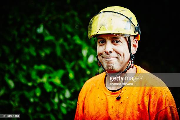 Portrait of smiling owner of tree pruning business