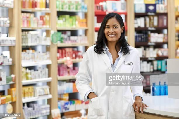 Portrait of smiling pharmacist at drug store