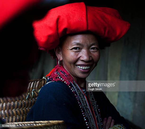 portrait of smiling red dao tribeswoman - hugh sitton stock pictures, royalty-free photos & images