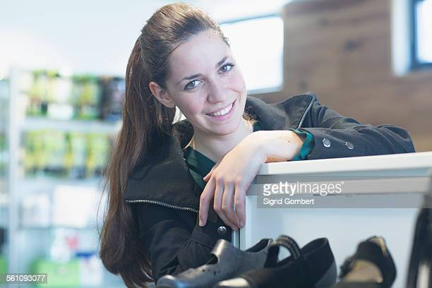 portrait of smiling sales assistant in shoe shop - sigrid gombert stock pictures, royalty-free photos & images