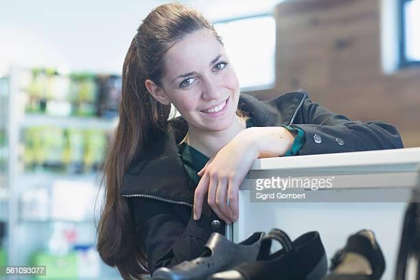 Portrait of smiling sales assistant in shoe shop