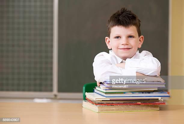 Portrait of smiling schoolboy in classroom