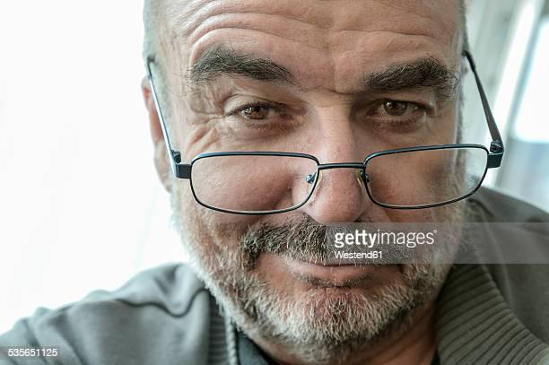 Portrait of smiling senier man wearing reading glasses