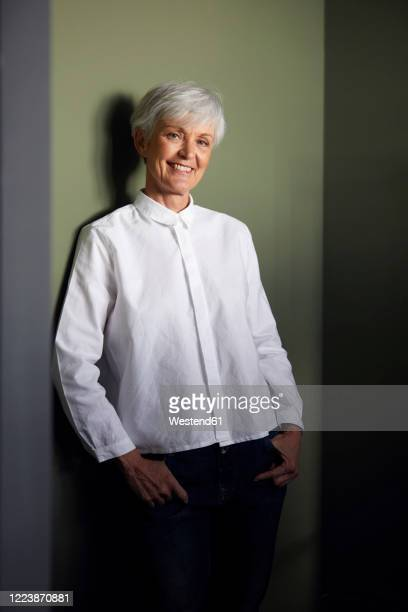 portrait of smiling senior businesswoman wearing white shirt - 白いシャツ 女性 ストックフォトと画像