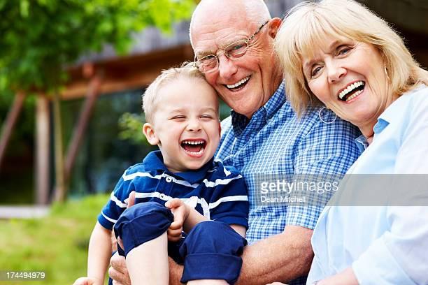 Portrait of smiling senior couple and little boy