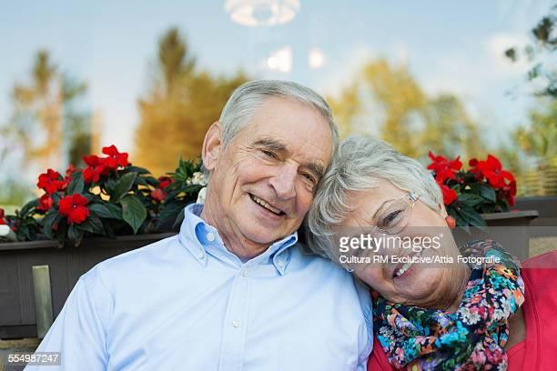 Portrait of smiling senior couple in garden