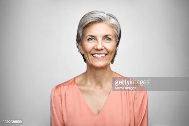portrait of smiling senior executive. - frauen stock-fotos und bilder