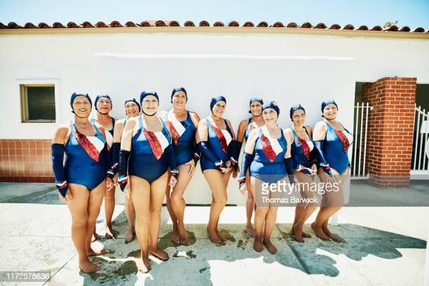 portrait of smiling senior female synchronized swim team - medium group of people stock pictures, royalty-free photos & images