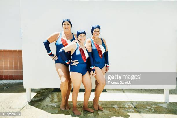 portrait of smiling senior female synchronized swim team - three people stock pictures, royalty-free photos & images