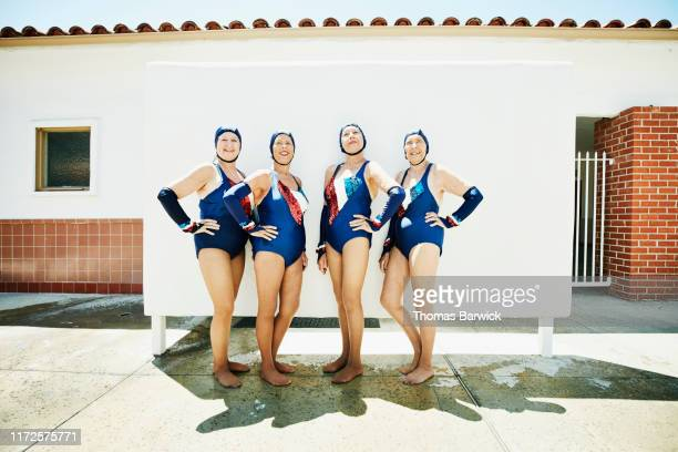 portrait of smiling senior female synchronized swim team - heroes stock pictures, royalty-free photos & images