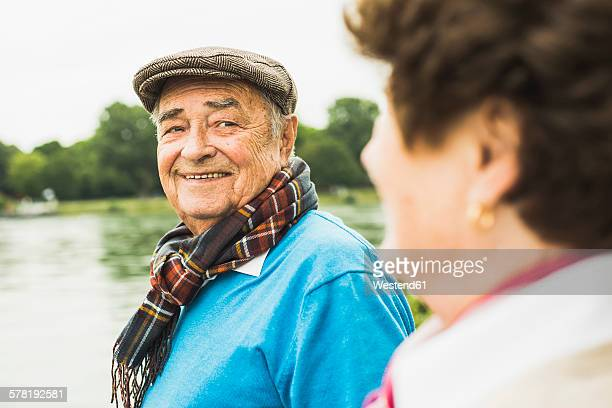 Portrait of smiling senior man face to face with his wife