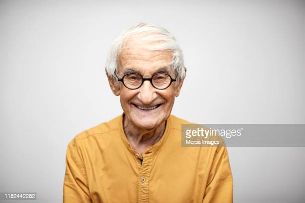 portrait of smiling senior man having white hair - individuality stock pictures, royalty-free photos & images