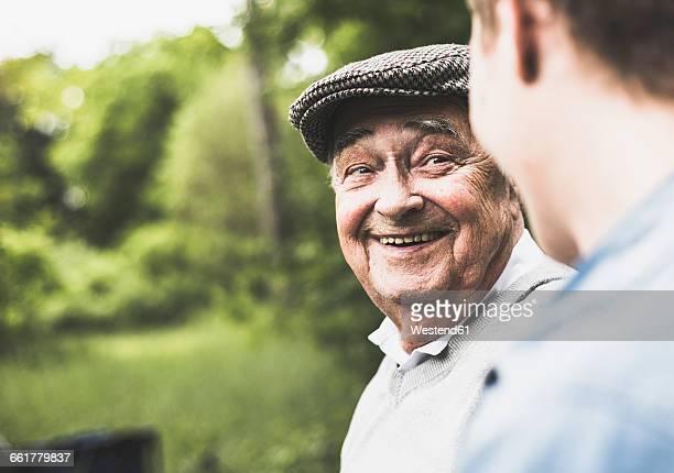 Portrait of smiling senior man looking at his grandson