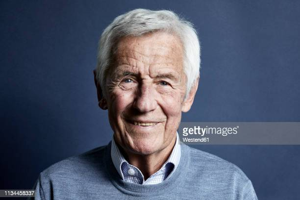 portrait of smiling senior man - senior stock-fotos und bilder