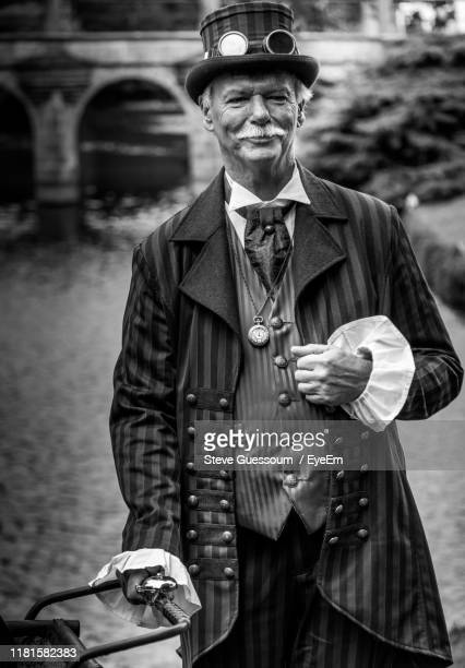 portrait of smiling senior man - steve guessoum stockfoto's en -beelden