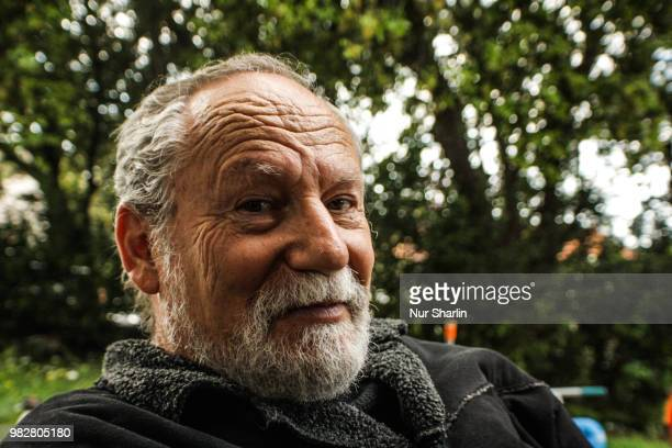 portrait of smiling senior man - israeli men stock photos and pictures