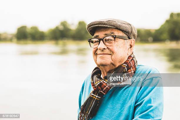 Portrait of smiling senior man wearing glasses and cap
