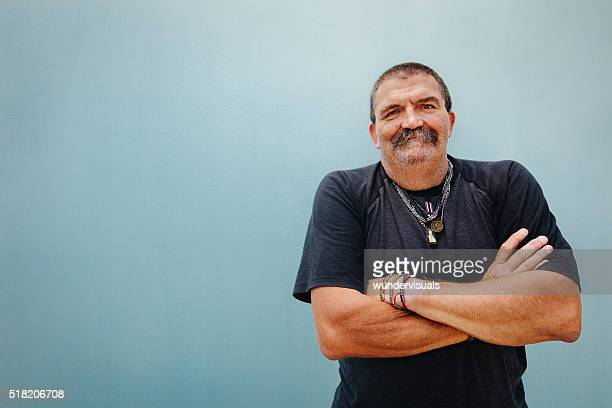 portrait of smiling senior man with crossed arms - eccentric stock pictures, royalty-free photos & images
