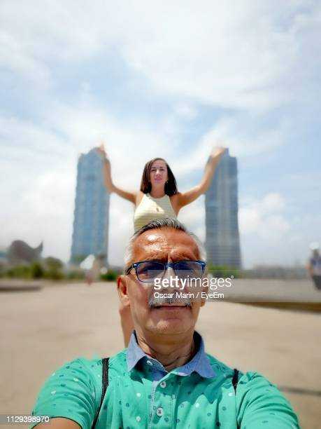 portrait of smiling senior man with daughter in background - oscar marin stock photos and pictures