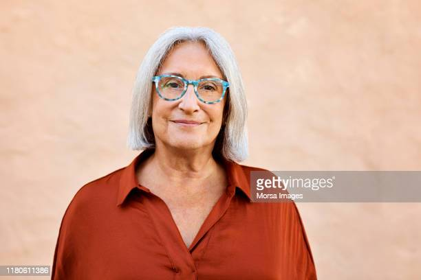 portrait of smiling senior woman wearing eyeglasses - one senior woman only stock pictures, royalty-free photos & images