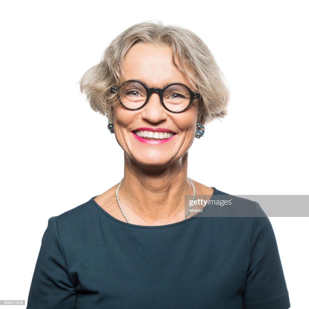 Portrait of smiling senior woman with eyeglasses : Foto de stock