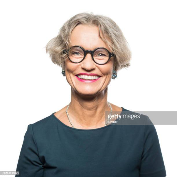 portrait of smiling senior woman with eyeglasses - white background stock pictures, royalty-free photos & images